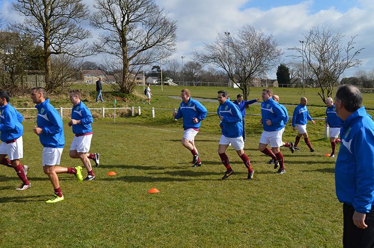 Players warm up ahead of the season opener against Kenanks Utd